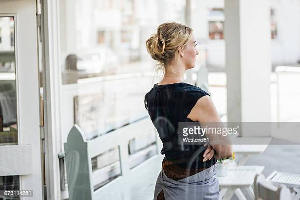 Woman in a cafe thinking