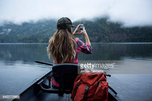 A woman in a canoe.