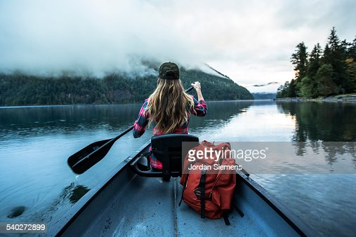 A woman in a canoe.