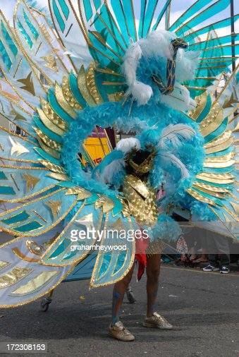 Woman in a carnival parade as a blue peacock