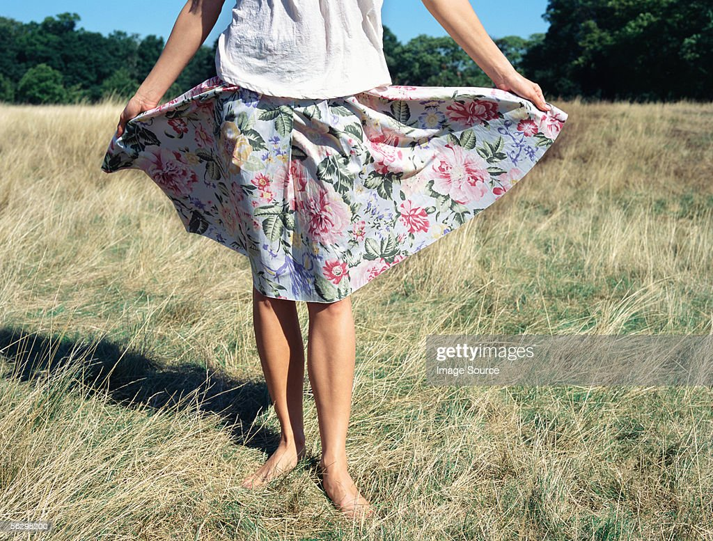 Woman in a floral skirt : Stock Photo