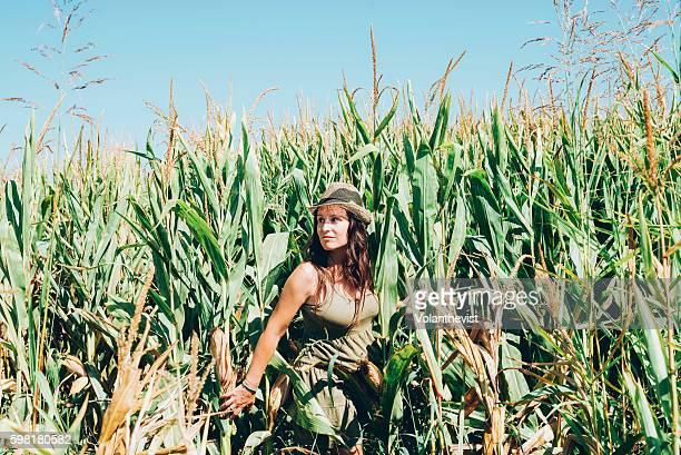 Woman in a green cornfield