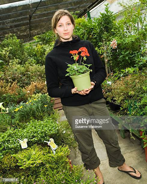 A woman in a greenhouse.