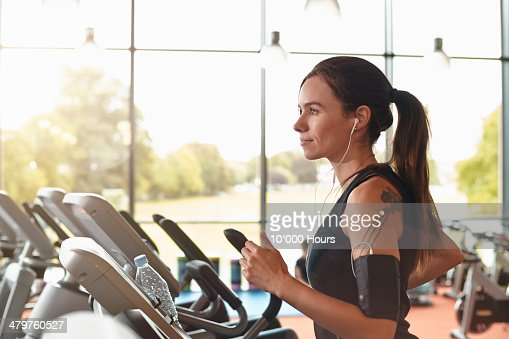 Woman in a gym on a running machine