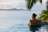 woman in a infinity pool jacuzzi at the resort spa