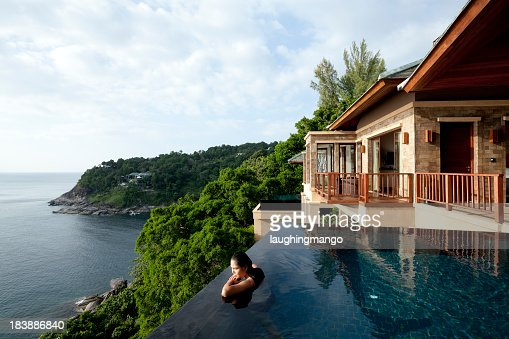 A woman in a oil overlooking Phuket, Thailand