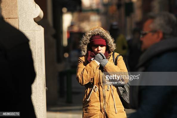 A woman in a parka walks on a Manhattan street during frigidly cold weather on February 16 2015 in New York City With temperatures in the teens New...
