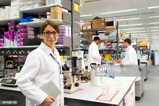 Woman in a Pharmaceutical Chemist Labratory