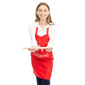 A woman in a red apron in the hands wooden cutting board on a white background. Isolation