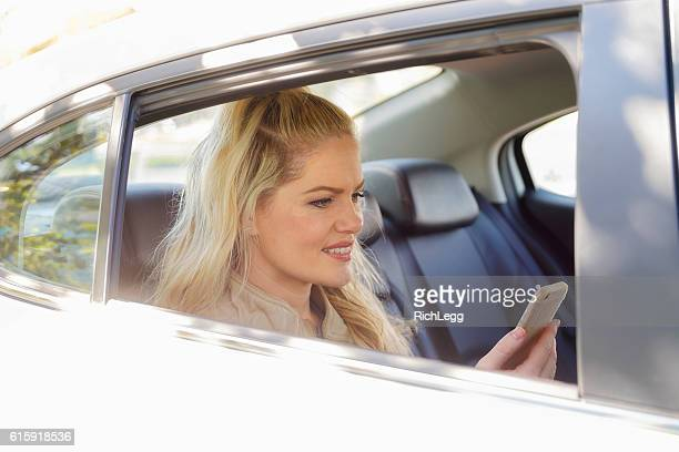 Woman in a Ride Share Taxi