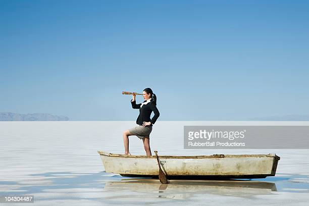 woman in a row boat in the middle of nowhere