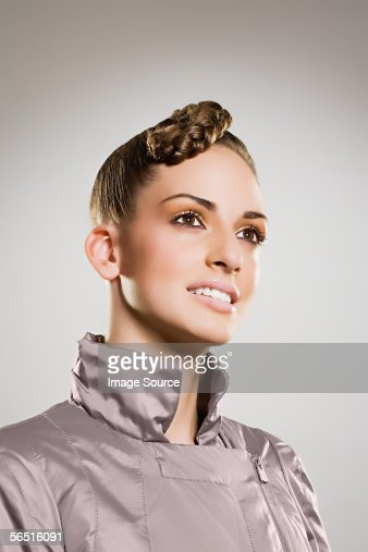 Woman in a silver jacket : Stock Photo