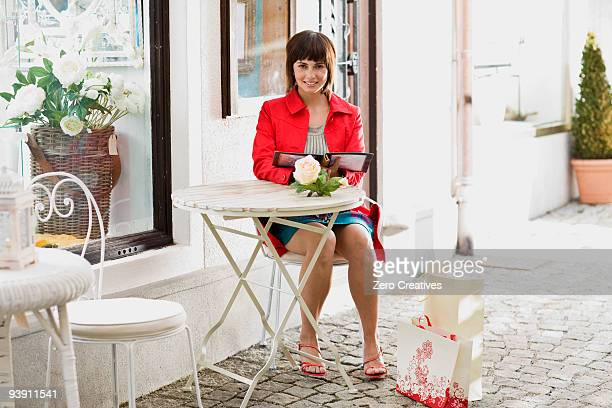 woman in a street cafe