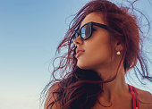 Close up portrait of brunette woman in a sunglasses.