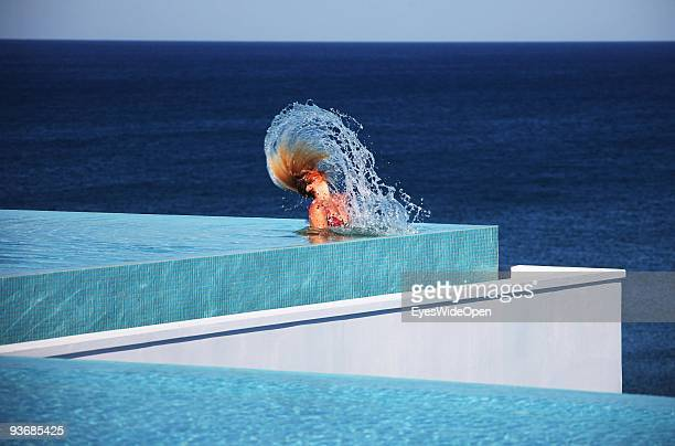 A woman in a swimmingpool near Lindos on July 16 2009 in Rhodes Greece Rhodes is the largest of the Greek Dodecanes Islands