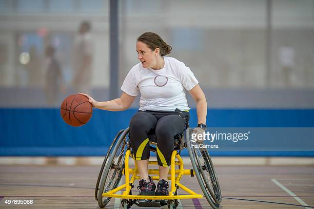 Woman in a Wheelchair Playing Basketball
