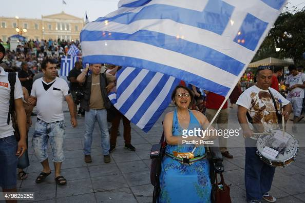 SQUARE ATHENS ATTICA GREECE A woman in a wheelchair waves a Greek flag Tens of thousands of Greeks came to the city center of Athens to celebrate the...