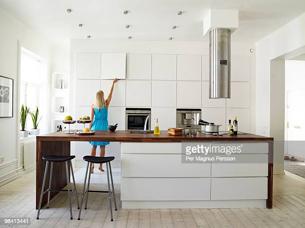 A woman in a white kitchen Sweden.