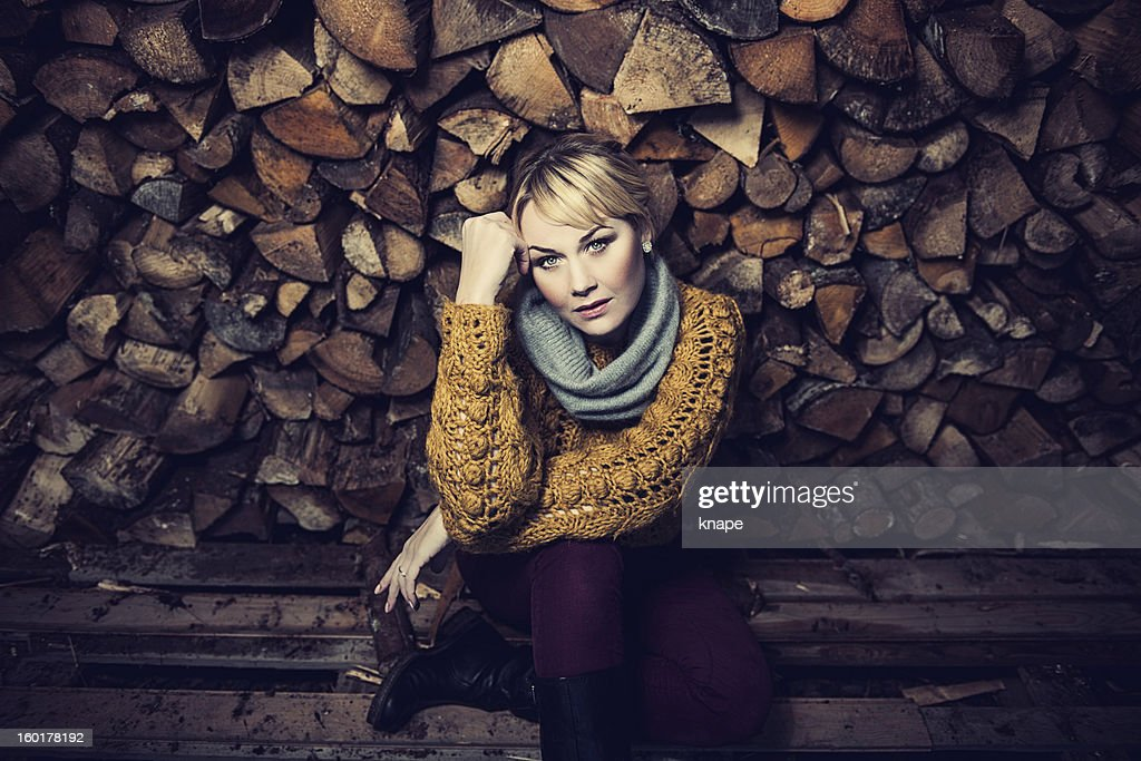 Woman in a woodshed : Stock Photo