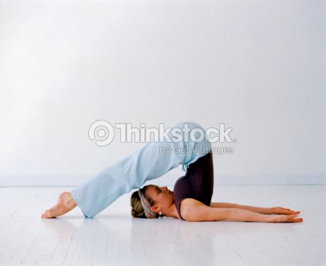 Woman in a yoga position : Stock Photo