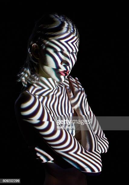 Woman in Abstract Lighting Looking to the Site