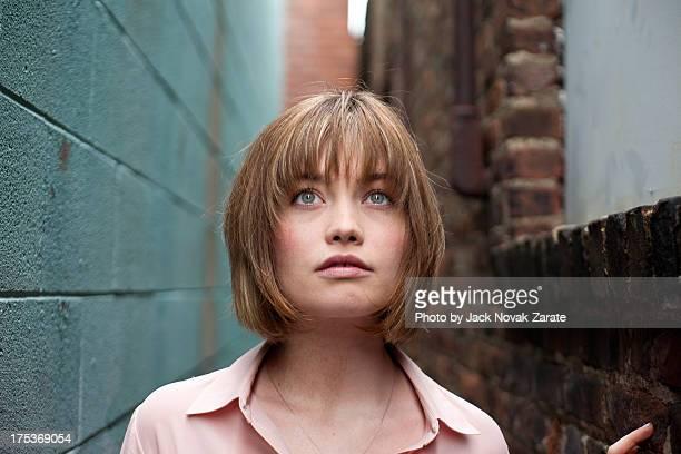 Woman in an alleyway