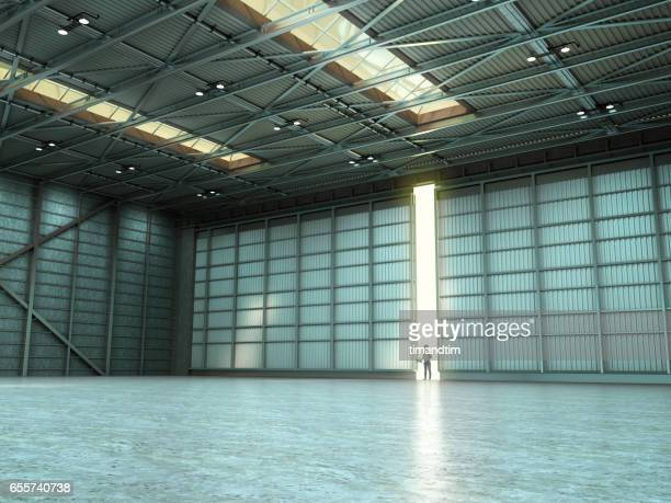 Woman in an empty warehouse by day