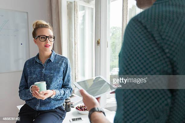 Woman in an office with cup of coffee