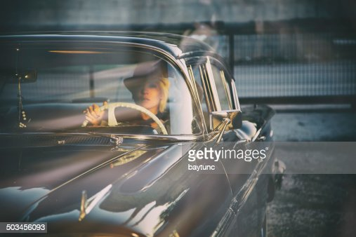 Woman in Antique Car
