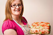 Woman in apron with freshly baked cake