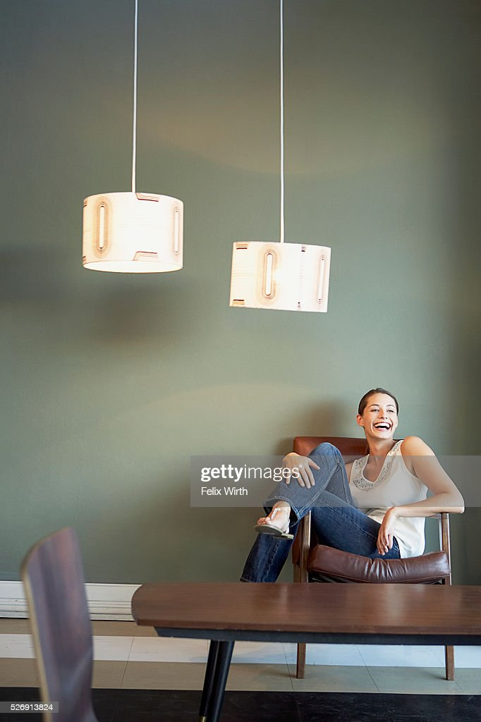 Woman in armchair : Stock Photo