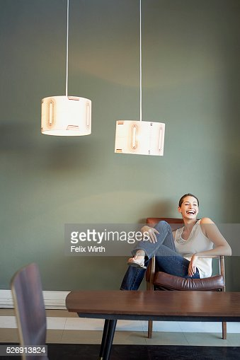 Woman in armchair : Stock-Foto