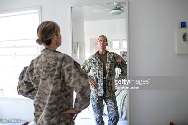 Woman in Army Uniform Looking at herself