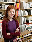 Woman in art supplies shop, smiling, portrait
