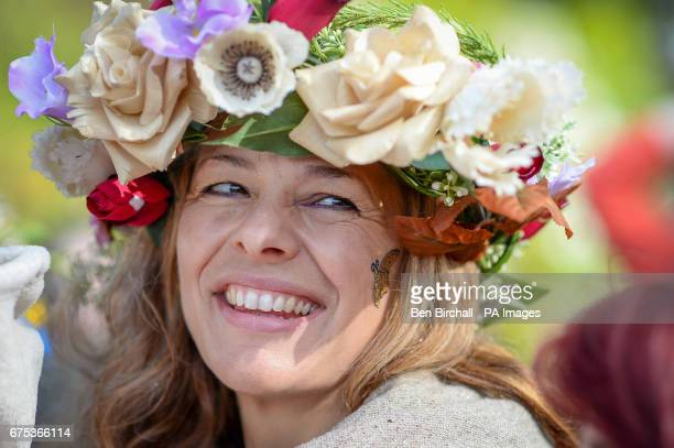 A woman in at Chalice Well Glastonbury where Beltane festivities are taking place on May Day