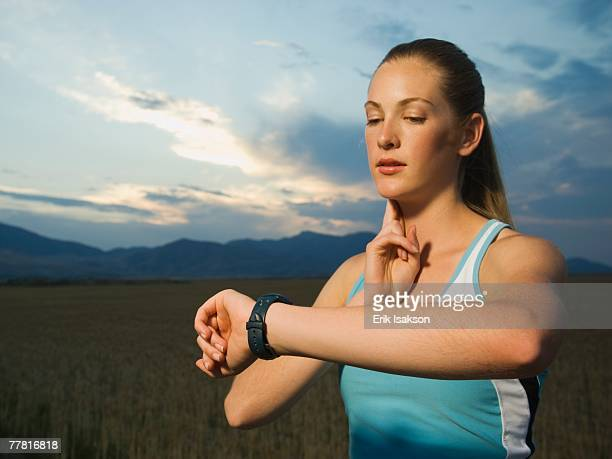 Woman in athletic gear checking pulse