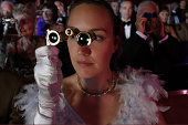 Woman in audience using opera glasses