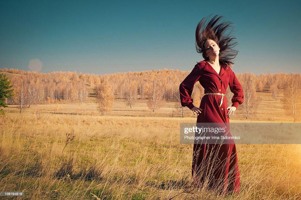 Woman in autumn surrounding : Stock Photo