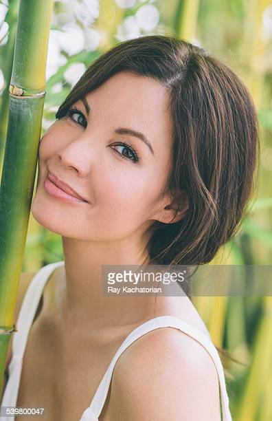 Woman in bamboo smiling into camera