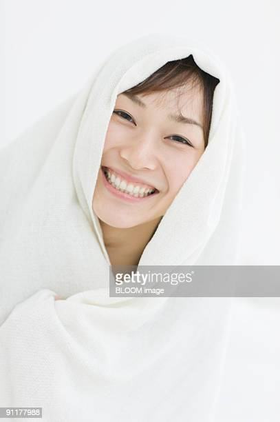 Woman in bath towel, smiling