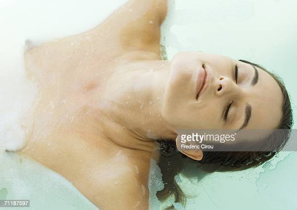 Woman in bath with eyes closed