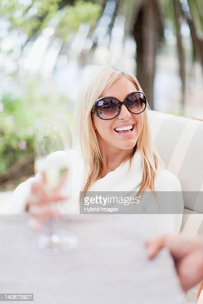 Woman in bathrobe relaxing in lawn chair