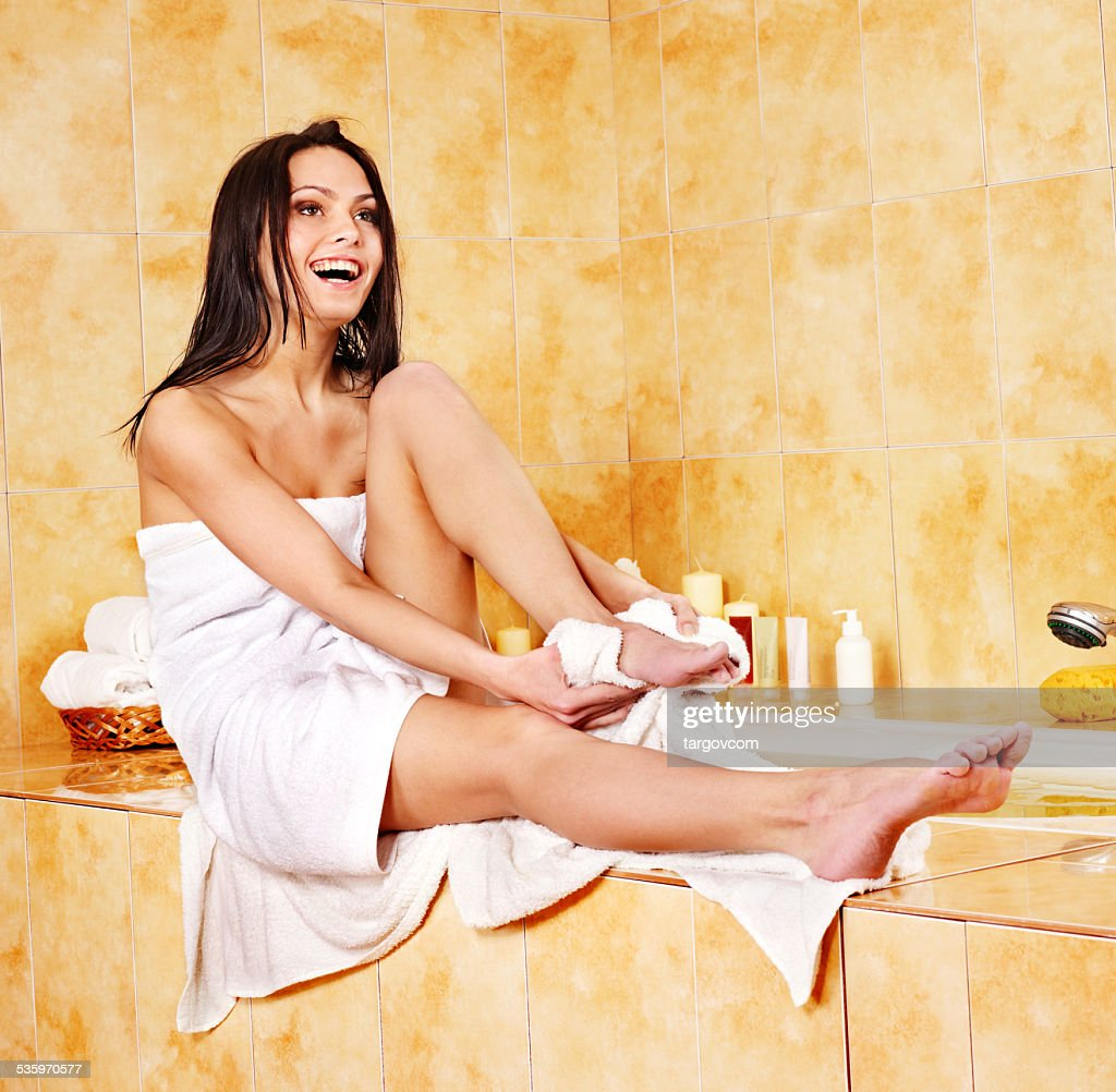 Woman in bathroom : Stock Photo