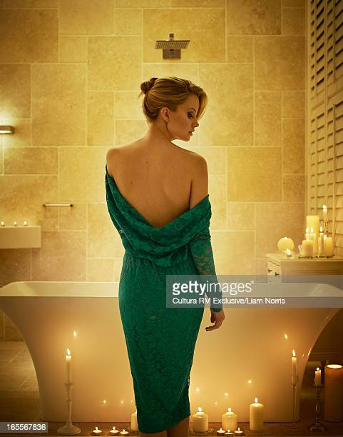 Woman in bathroom with candles