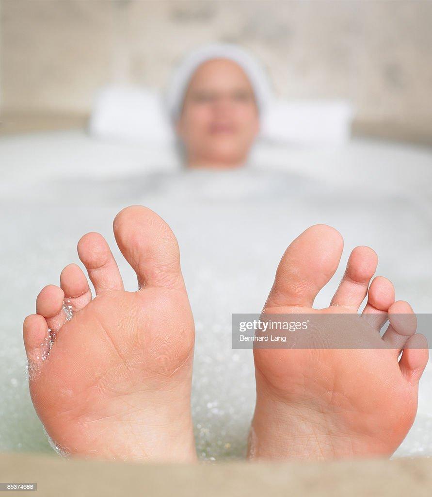 Woman (36y) in bathtub : Stock Photo