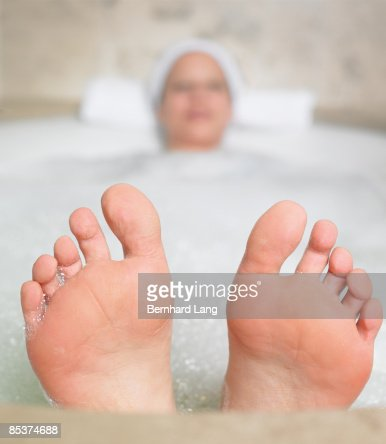 Woman (36y) in bathtub : Stock Photo