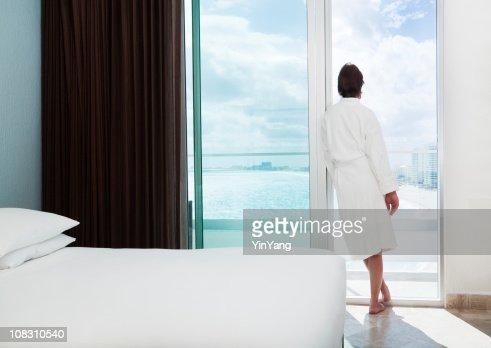 Woman in Beach Resort Hotel Room Relaxing, Admiring Balcony View : Stock Photo