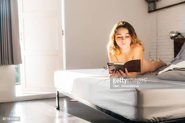 Woman in bed after shower