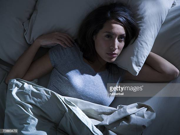 Woman in bed in the dark