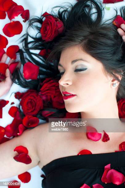 Woman in bed of roses